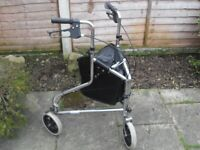 Mobility walker with bag in good condition.