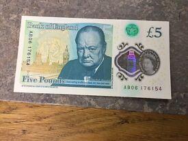Crisp new £5 note AB06 edition