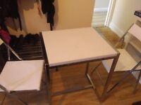 Folding dining/kitchen table and 2 white folding chairs
