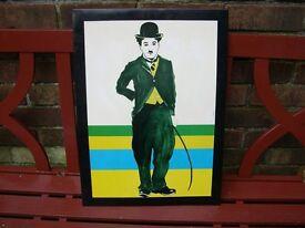 A JRM tin print of Charlie Chaplin.