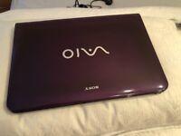 Sony i3 laptop. purple. window 7 4gb memory. 2.4ghz. 284gb storage. bluetooth.