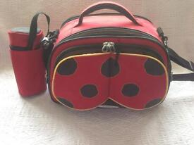 Red ladybird design changing bag by samsonite