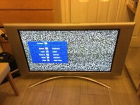 Philps 42 inch wide screen TV with built in surround speakers