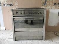 SMEG stainless steel range and extractor