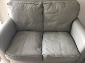Leather Sofa, Footstool and Two Armchairs.