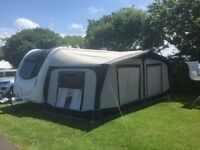 2014 Swift Conqueror 570 4 Berth Caravan with Fixed Bed, End Washroom, Motor Mover, Bradcot Awning.