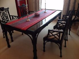 William MacLean (Brighton) Chinese-style hand-crafted dining table with glass top, and six chairs.