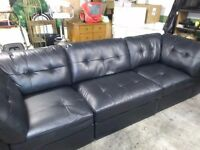"Black leatherette sofa comes in 3 pods. Size 10ftx 3ft6"" black. Also electric free standing fire"
