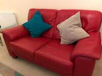 3 and 2 seater red leather sofas with glass side and coffee tables
