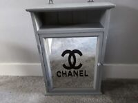 Upcycled mirrored cabinet.