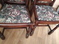 Dark oak wood extending table and 4 chairs