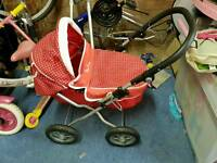 Girls silver cross dolls pushchair