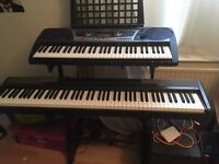 2 Keyboards, with cases and dual keyboard stand