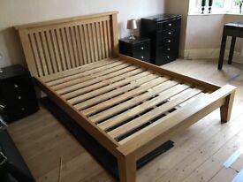 Solid oak double bed .