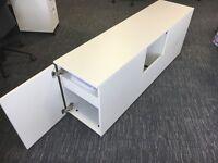 White, desk-side cabinets.