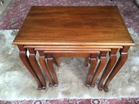 Light mahogany nest of four tables