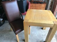 2 chairs and a solid Oak table