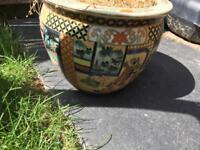 Decorated vintage garden pot