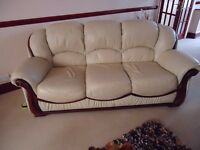 Cream leather 3 piece suite with mahogany trim. Excellent condition, no marks, scratches or stains.