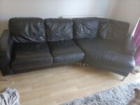 Large black leather sofa, armchair and footstool for sale