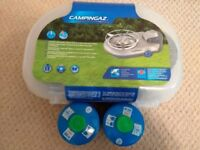 BRAND NEW camping stove + 2 gas canisters