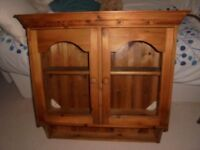 Pine cabinet with glass doors.