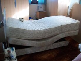 Adjustable single bed , reclining action
