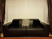 Two large 2 seater sofa's