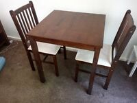 Small two person dining table and chairs.