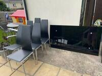 Black glass table with 6 chairs