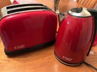 Kettle, toaster, microwave, towels, utensil holder, T,C&S holders