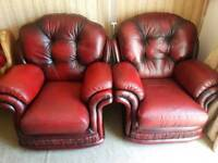 THOMAS LLOYD OX-BLOOD PAIR LEATHER ARMCHAIRS