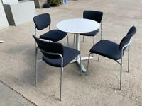 White coffee table 700mm diameter & 750mm high with 4 matching chairs