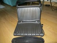 George Foreman 4 portion grill .Hardly been used . still in excellent condition