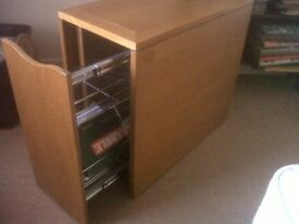 Dropside table, good condition, solid wood with drawer and reversible centre piece for hot dishes.