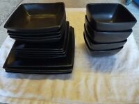 Set of black plates and bowls