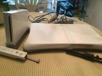 WII + WII FIT BOARD RARELY USED GREAT CONDITION