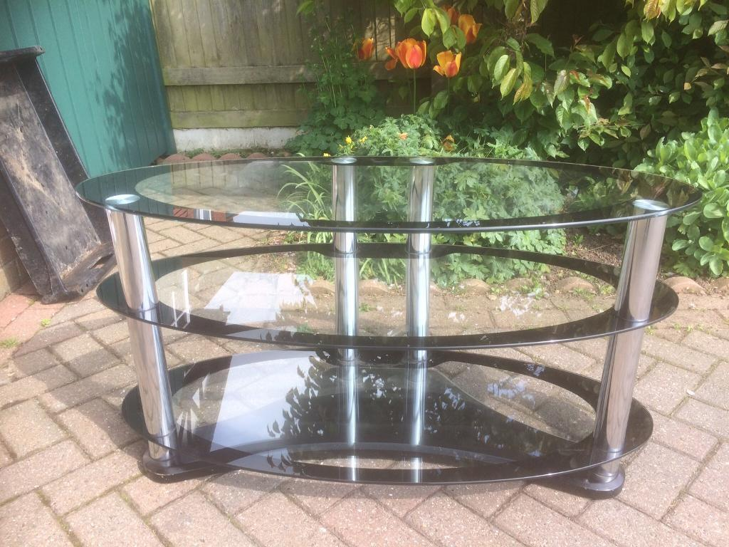 Glass TV standin Scarborough, North YorkshireGumtree - Stylish glass TV stand, sturdily made with one pice wooden foot.Local collection only please