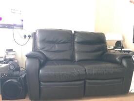 Black leathers sofas