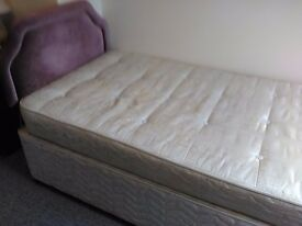Single divan bed with mattress and padded headboard