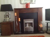 Next maple wood fire surround with electric fire.