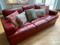 Reid's- Dark Red Leather 3 Seater Sofa & matching footstool. (Used in good condition)