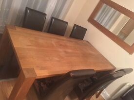 Hard wood, very sturdy dinning table with 6 chairs for quick sale
