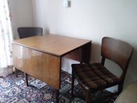 Table with two folding extendable leaves and 4 matching chairs