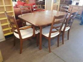 Large G-plan extendable table with six chairs