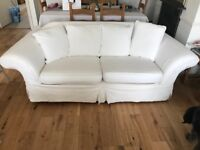 Cream 3 seater sofa, armchair and footstool with matching arm covers