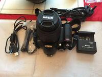 Nikon D5000 12.3MP Digital SLR Camera and Nikon DX AF-S Nikkor 18-55mm 1:3.5-5.6G Lens