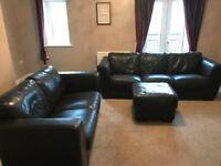 Furniture Village Scotchguarded chocolate brown leather 2 and 3 seater sofas and matching footstool