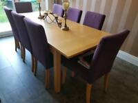 Dining table light oak effect and eight matching chairs