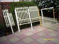 Trellis pieces including a gate.